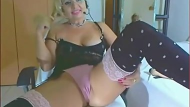 Naughty granny teasing on webcam