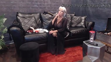 Smoking mature mistress Sally in sexy lingerie rides toy