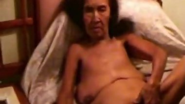 Asian granny naked and smoking.