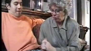 Classic granny jerking and grandmother sucks grandson cock