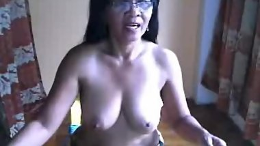 filipina granny showing her big tits on cam for me
