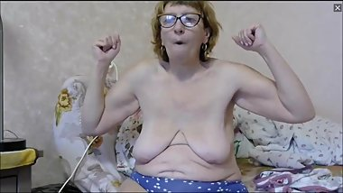 Gross Russian granny flexes her saggy tits and biceps