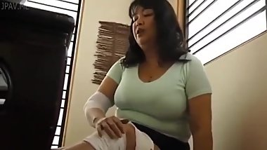 Mature japanese MILF fingering her panties and masturbating