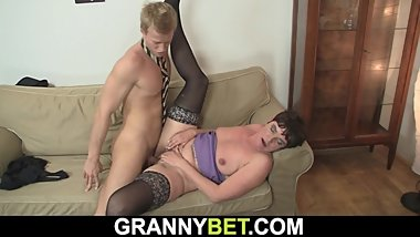 Hairy 60 years old woman in stockings spreads legs for him