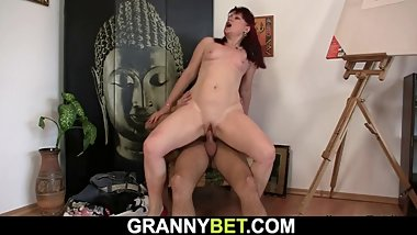 Very beautiful redhead mature woman rides his cock