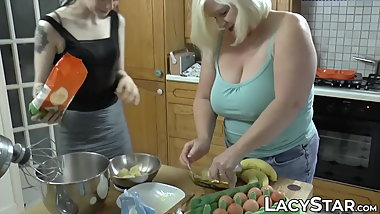 Big tits GILF sensually fucks younger chick in the kitchen