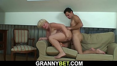 He helps busty blonde granny and gets hot blowjob in return