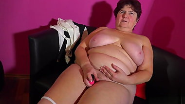 Granny Hanna fucks herself with a pink vibrator