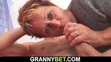 He fucks short-haired mature woman on the floor