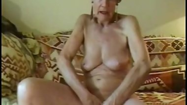 Old, blonde granny Olga masturbating.