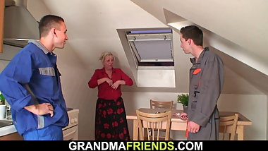 Busty old grandma spreads legs for two repairmen