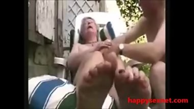 Horny granny playing in court yard. Amateur older