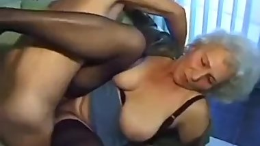 Granny porn star fucking on a couch with a guy.