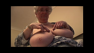Massive tits granny masturbates with her toy