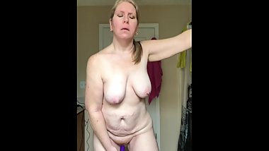 selfshot saggy granny Michelle stands and plays