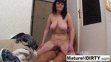 Busty brunette granny sucks & fucks lucky stud on the floor!