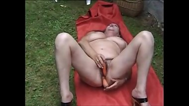 Dirty hairy grandma masturbating and pissing in the garden