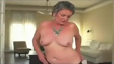 Old granny porn star Sandora pleases herself, then has sex.