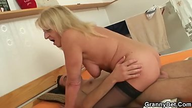 Old, blonde granny fucks a man.