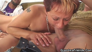Old granny swallows two cocks at once