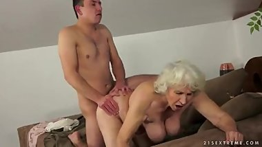 Grandma porn star Norma with yet another young guy.