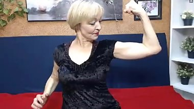 Russian milf babe flexes her biceps