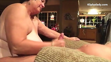 Fat granny give an energic handjob to her hubby