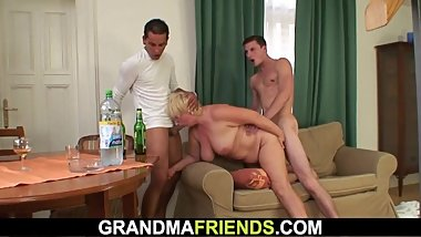 Drunk blonde granny is picked up and double fucked