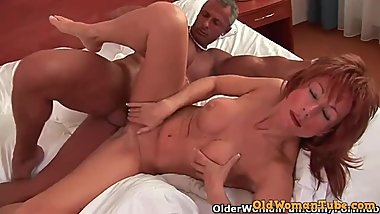 Redheaded gilf with firm tits gets a facial