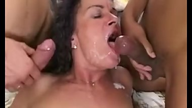 Granny porn star Sandora in a threesome.