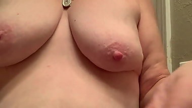Slut playing with her titties
