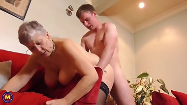 Boy having sex with busty British granny